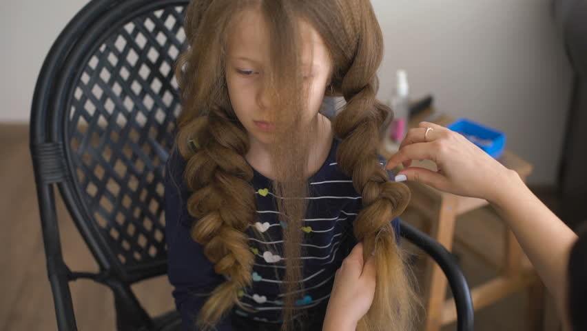 Mom Makes Hairstyle For A Stock Footage Video 100 Royalty Free
