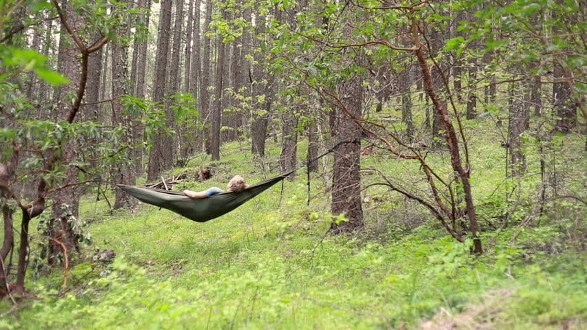 A looping video of a person relaxing in nature