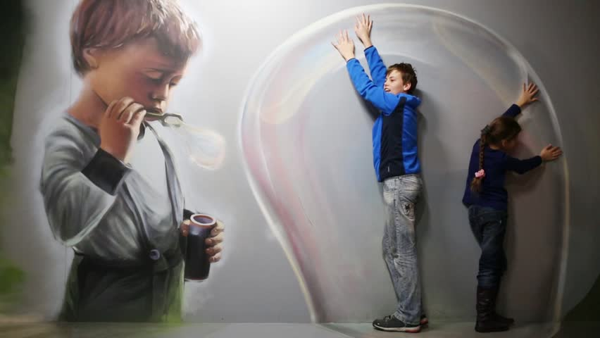 MOSCOW - MAR 24, 2015: Girl and boy (with model releases) in bubble in optical illusions Museum at VDNKh | Shutterstock HD Video #16114000