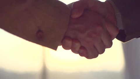 Businessmen shaking hands in the office, closeup. Good deal, business concept. Two unrecognizable business people, Business handshake. Slow motion 240 fps, HD 1080p stock video footage