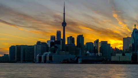 City of Toronto Sunset Time Lapse Day To Night 4K 1080p - Sun setting behind the city of Toronto Canada day to night skyline shot