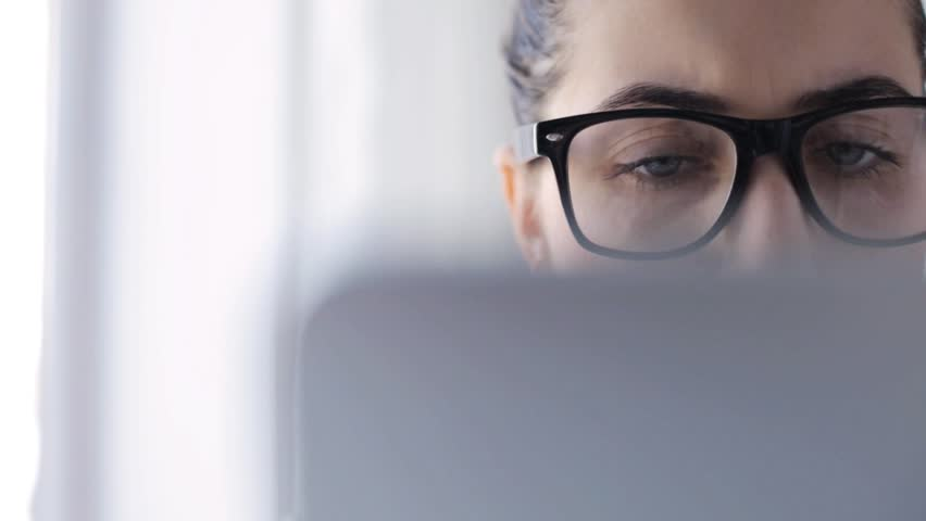Education, business, people, technology and leisure concept - young woman in eyeglasses with tablet pc computer at home | Shutterstock HD Video #16206550