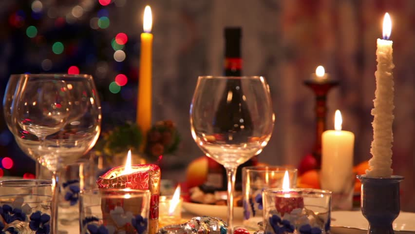 Dinner Table Background decorated christmas dining table with bottle, glasses, candy