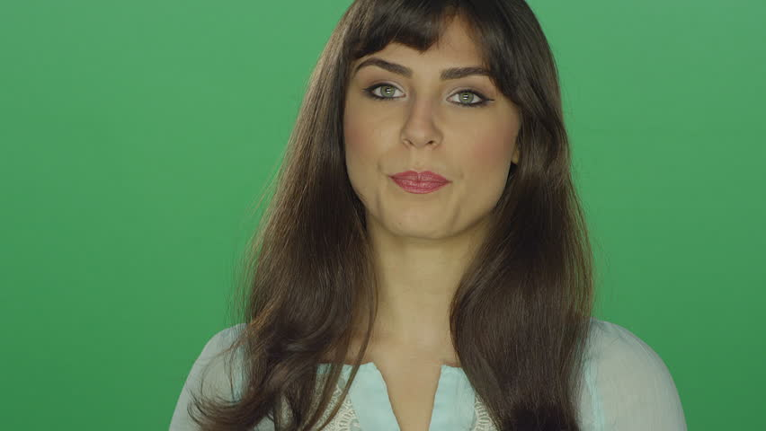 Beautiful brunette woman smiling, on a green screen studio background | Shutterstock HD Video #16252900