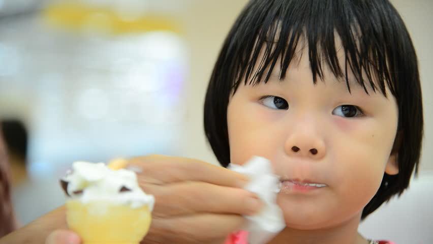 Asian girl eating ice cream   Shutterstock HD Video #16255720