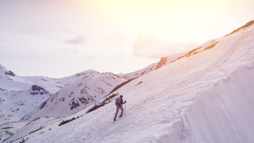 Climber Man Walking Up Mountain At Sunset Reaching The Top Success Fly Over Aerial Drone Footage | Shutterstock HD Video #16267582