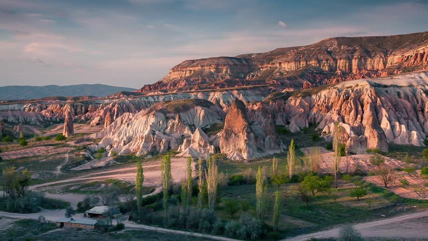 Unreal world of Cappadocia. Sunset in Red Rose valley in April. Cavusin village located, district of Avanos in Nevsehir, Turkey, Asia. Full HD video (High Definition). Exported from RAW file.