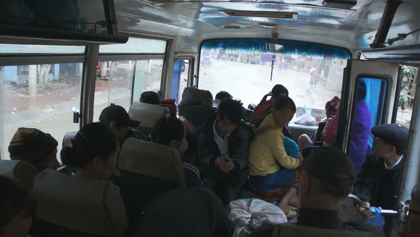 BAC HA, VIETNAM - FEBRUARY 23, 2013: tourists in the local bus in the Bac Ha, Vietnam. #16310380