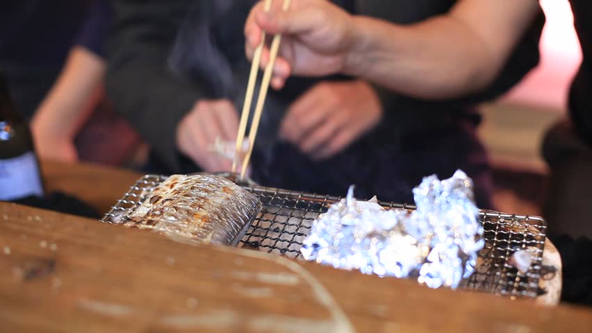 Casual shot of people eating with chop sticks  | Shutterstock HD Video #16313320