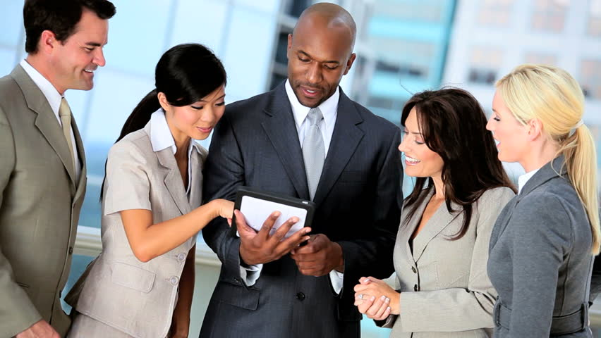 Young Multi Ethnic Business Team Using Modern Technology | Shutterstock HD Video #1631356