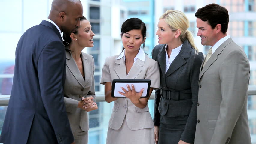 Young Multi Ethnic Business Team With Wireless Technology | Shutterstock HD Video #1631950