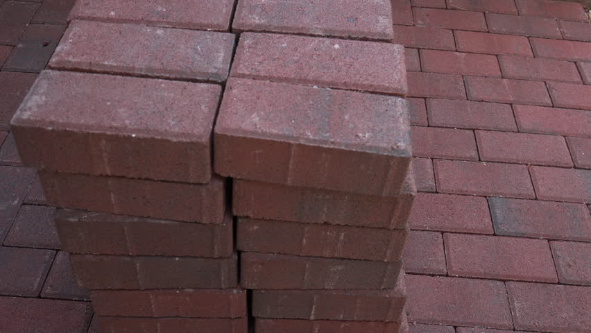 Time Lapse, Worker Wears Gloves, Stacks Additional Rows Of Brick Pavers  Next To Adjacent