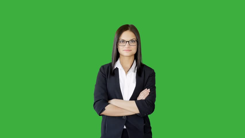 Young confident businesswomen standing against green screen background. attractive female professional model isolated on chroma-key