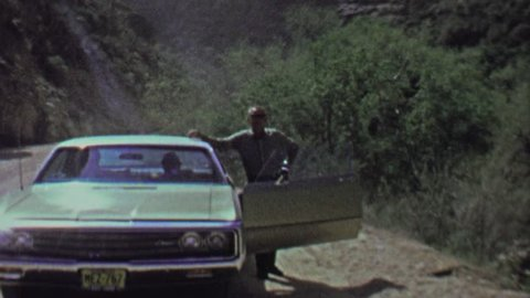 ROOSEVELT, ARIZONA 1961: Impatient dad family pulls over while family waits in car.