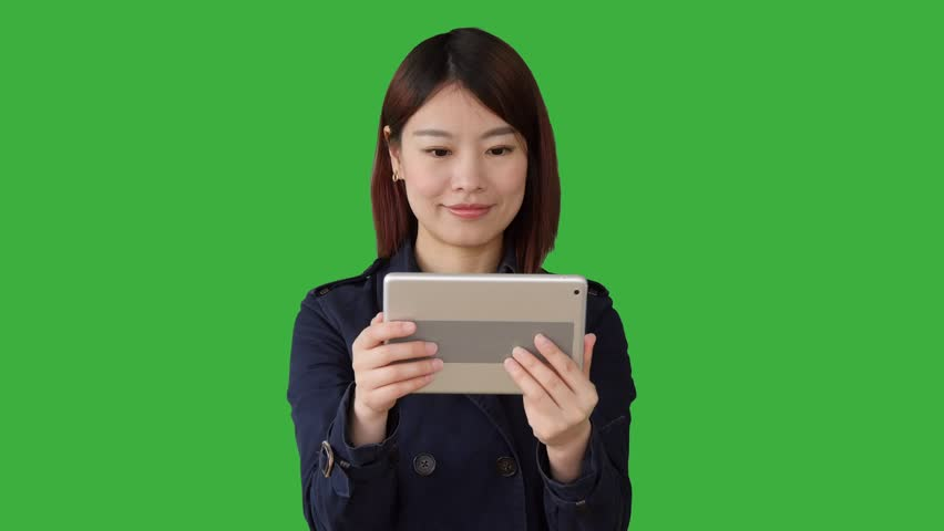 eeb4a162ecb young asian women standing isolated against green screen background.  portrait of chinese female person.
