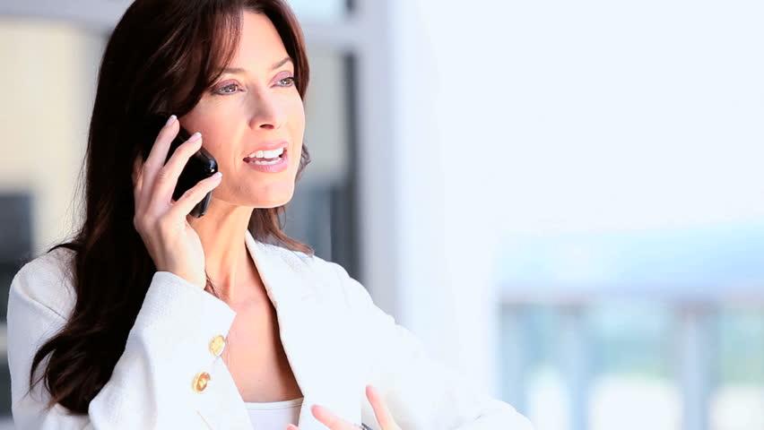 Businesswoman Receiving Good News on Smartphone | Shutterstock HD Video #1635100