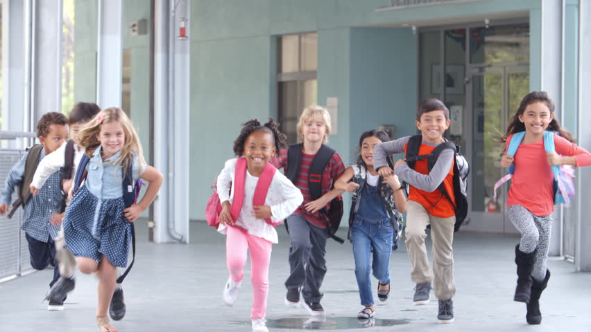 Group of elementary school kids running in a school corridor | Shutterstock HD Video #16355920