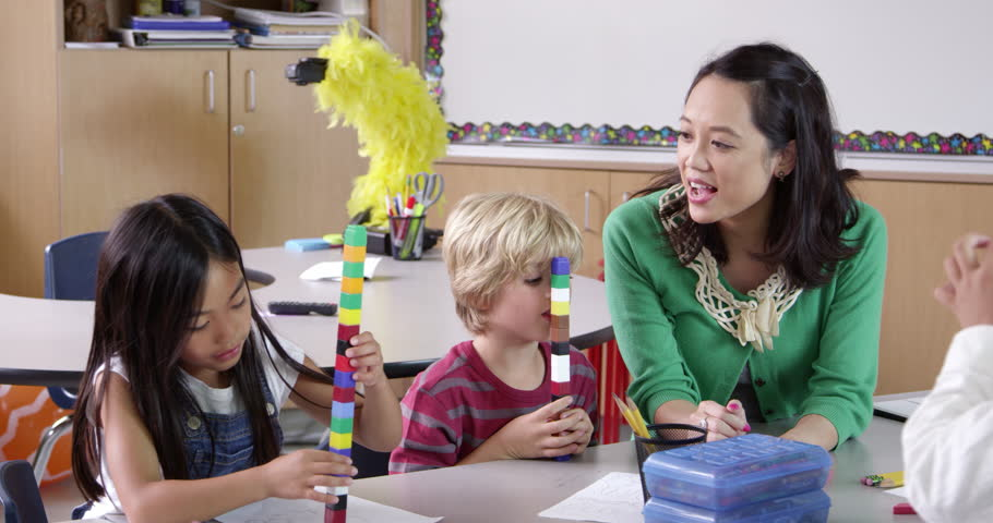 Teacher sits with kids using blocks in class, shot on R3D | Shutterstock HD Video #16357441