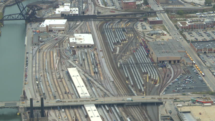 aerial Chicago rail yards zoom reveal suburbs