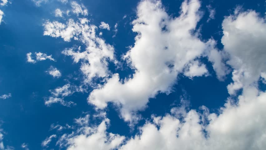 Time lapse: beautiful cloudscape with fluffy white clouds on a deep blue sky. #16382140