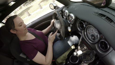 Woman distracted while texting and driving