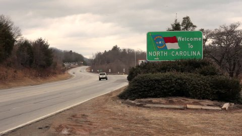 NORTH CAROLINA, USA - 2 FEB 2014: View of North Carolina welcome sign with vehicles moving