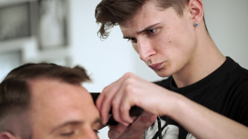 Barber Cuts The Hair In Stock Footage Video 100 Royalty Free