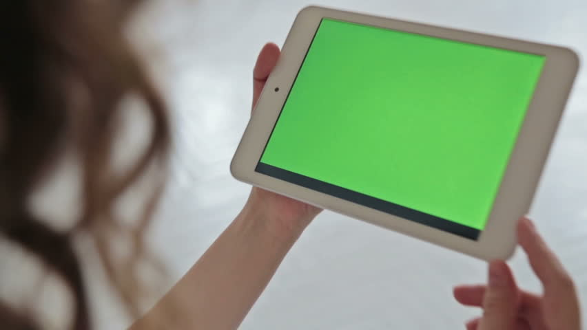 Back view of woman at home using electronic tablet, green screen | Shutterstock HD Video #16516237