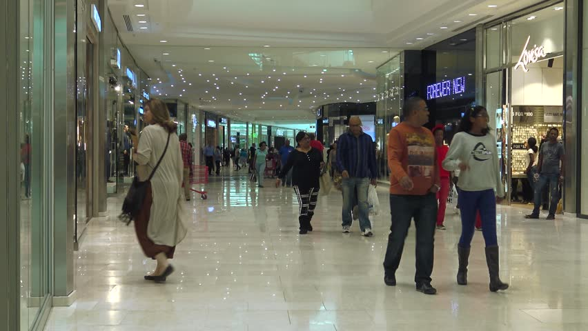 JOHANNESBURG, SOUTH AFRICA - 7TH MAY 2016: Hundreds of shoppers of various ethnic backgrounds walk through the newly opened Mall of Africa in Johannesburg.