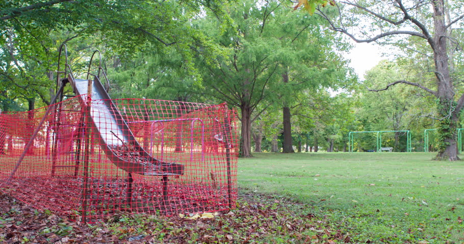 playground slide quarantined in park pan shot 4k broken shiny metal slide surrounded by orange plastic bru te woman resting in hammock after a party on the backyard      rh   shutterstock