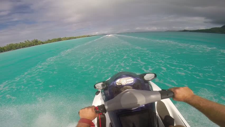 POV of man riding a personal watercraft in the lagoon around Bora Bora island in French Polynesia. - Slow Motion - Model Released - 1920x1080 - Full HD