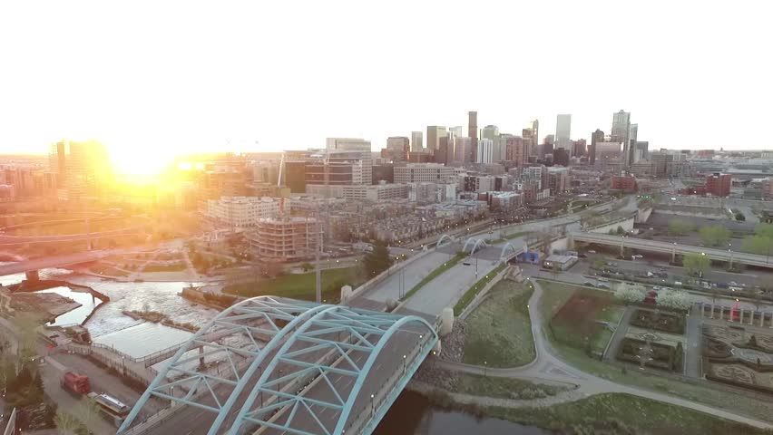 Aerial Drone Footage of Downtown Denver at Sunrise over Platt River and Speer Bridge | Shutterstock HD Video #16590940