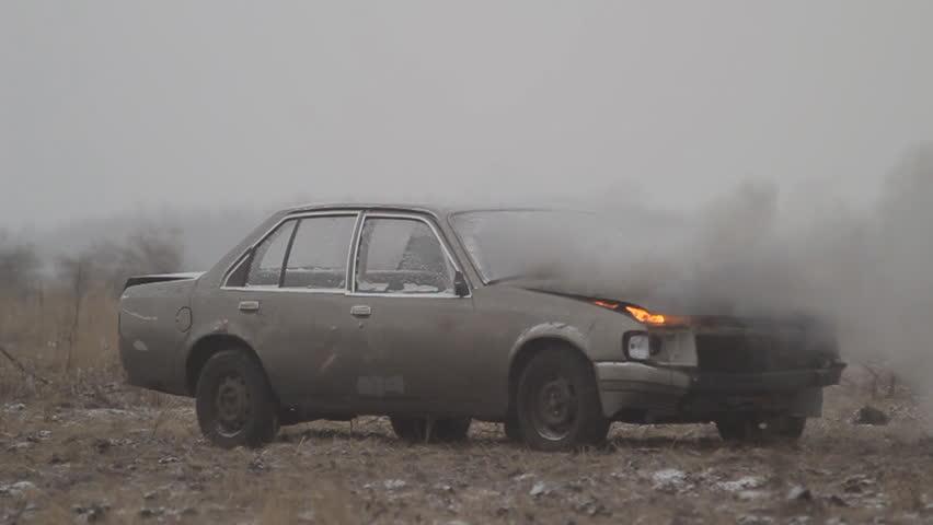 Car explosion on an empty field
