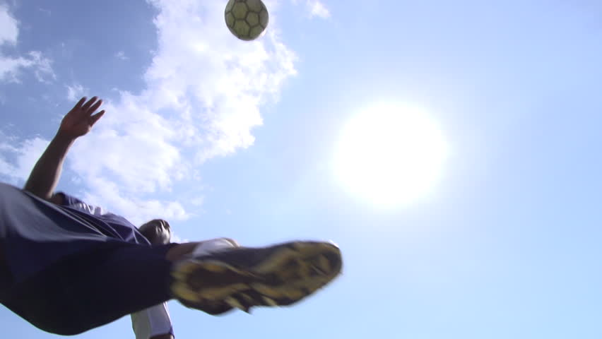 A man playing soccer on a grassy field. - Super Slow Motion - Model Released - 1920x1080 - Full HD - filmed at 240 fps