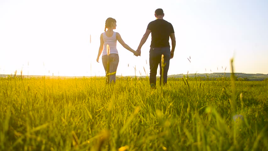 Lovers man and woman are on the green grass and smiling | Shutterstock HD Video #16683370