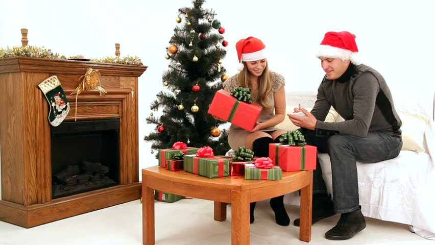 Christmas spirit. Young girl and man sign gifts to avoid confusion.