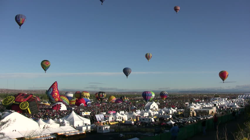 ALBUQUERQUE, NM - OCTOBER 8: Crowds cheer hot air balloon flight crews during the International Balloon Fiesta in Albuquerque, NM on October 8, 2011