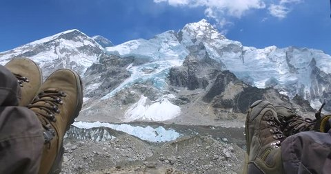 tourist background Feet on the Khumbu Glacier and the base camp of Mount Everest - Nepal, Himalaya.
