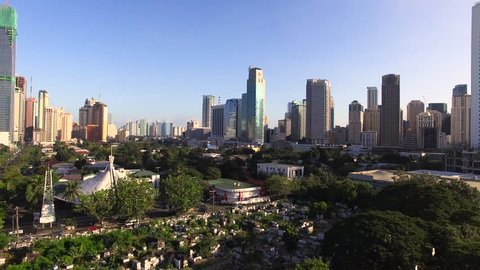 Makati - 20 JAN: Crane up view of buildings and houses on 20 January 2016 in Makati, Philippines