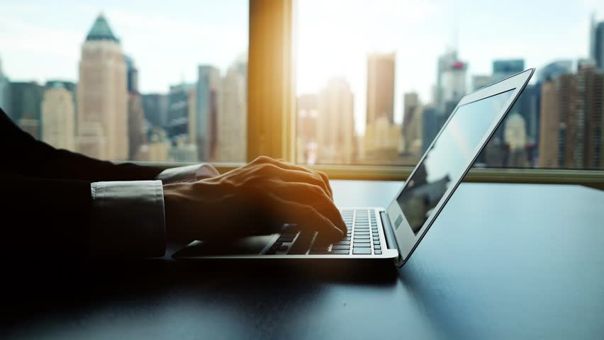 Working on laptop computer in modern office desk analyzing financial  profits progress. business charts diagrams background. online banking from home. city skyline window view  | Shutterstock HD Video #16830700