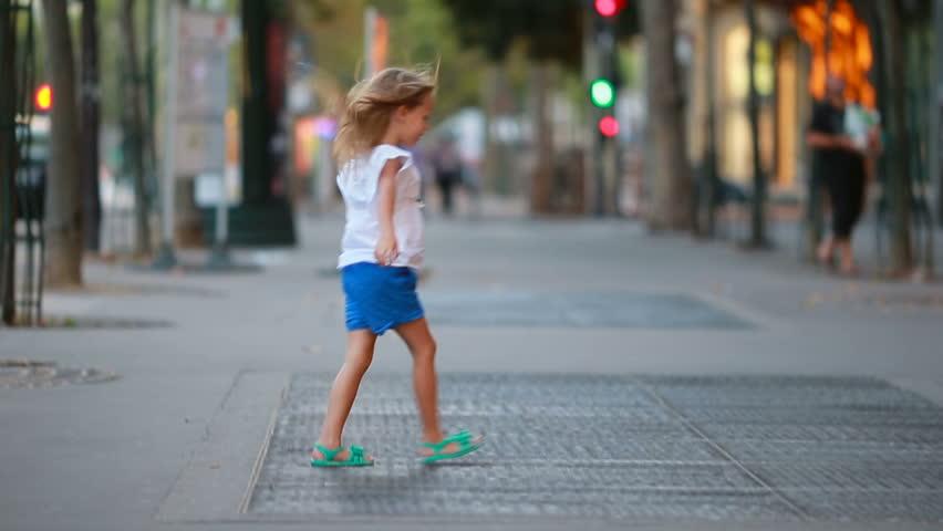 Adorable little girl at european city outdoors