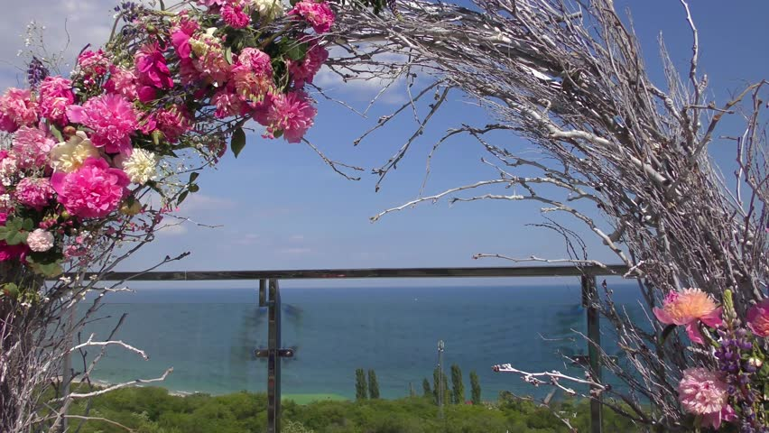 Wedding flower arch decoration wedding arch decorated with wedding flower arch decoration wedding arch decorated with flowers on the beach stock footage video 16856920 shutterstock junglespirit Choice Image
