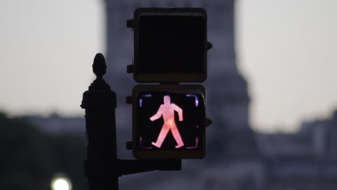 Buenos Aires, Argentina - November 10, 2013: Pedestrian crosswalk lights changing from walk signal to stop signal