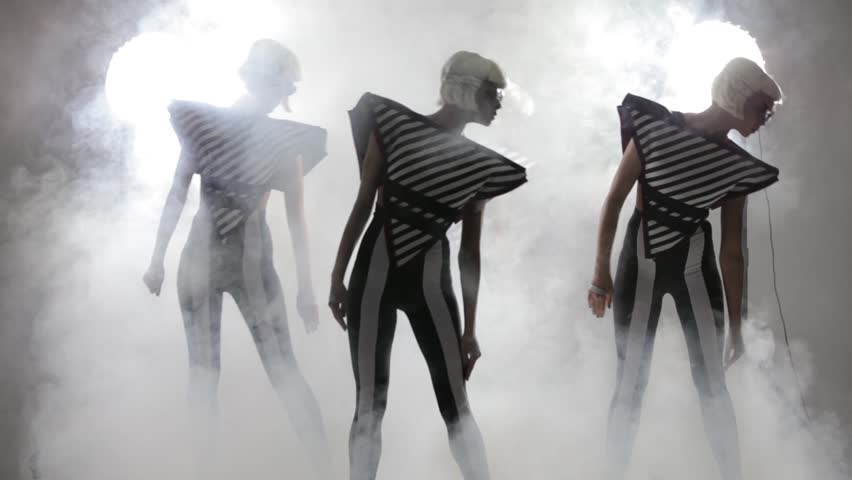 Dancing girls in a smoke on a white background