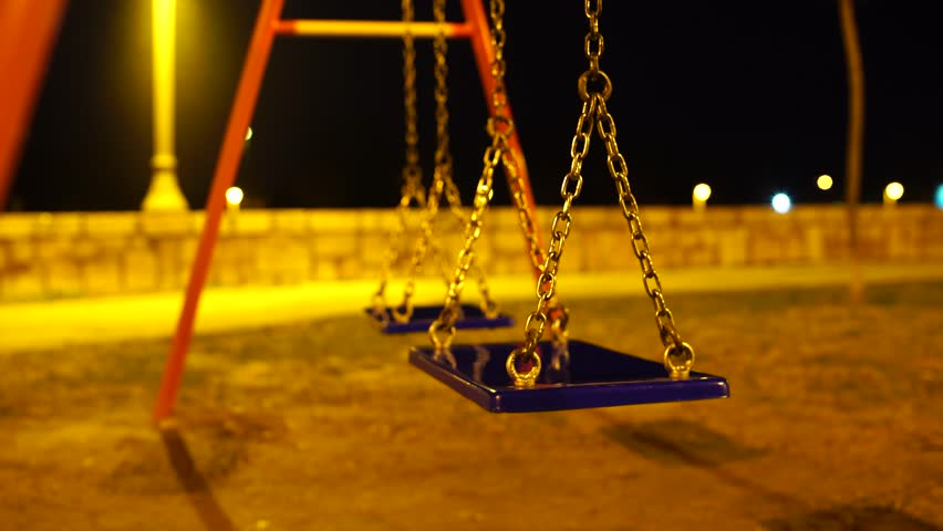 Empty Playground Swings At Night Stock Footage Video