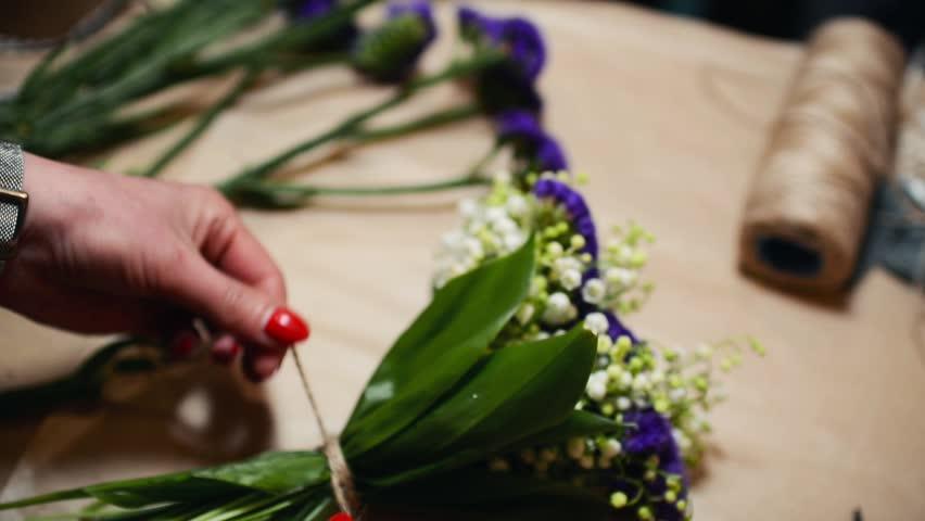 Flower Shop, Florist Arranging Modern Bouquet, Tying Ribbons to Make a Bow | Shutterstock HD Video #16874770