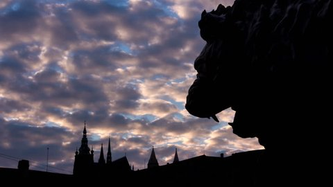 Silhouette of a lion statue in front of the Prague castle time lapse 4K