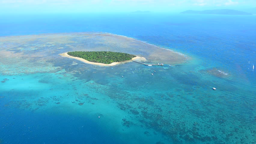 Aerial view of Green Island reef as view from helicopter flight at the Great Barrier Reef near Cairns in Tropical North Queensland, Queensland, Australia. | Shutterstock HD Video #16953490