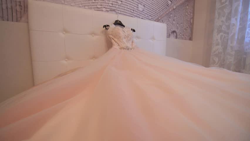 Wedding dress hanging on a shoulders | Shutterstock HD Video #16959526