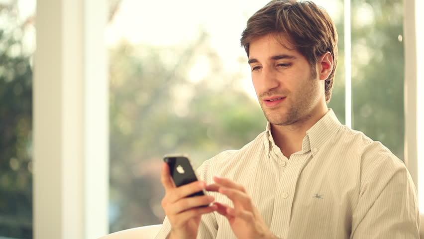 Buenos Aires, Argentina - June 27, 2014: Man using smartphone | Shutterstock HD Video #16996810